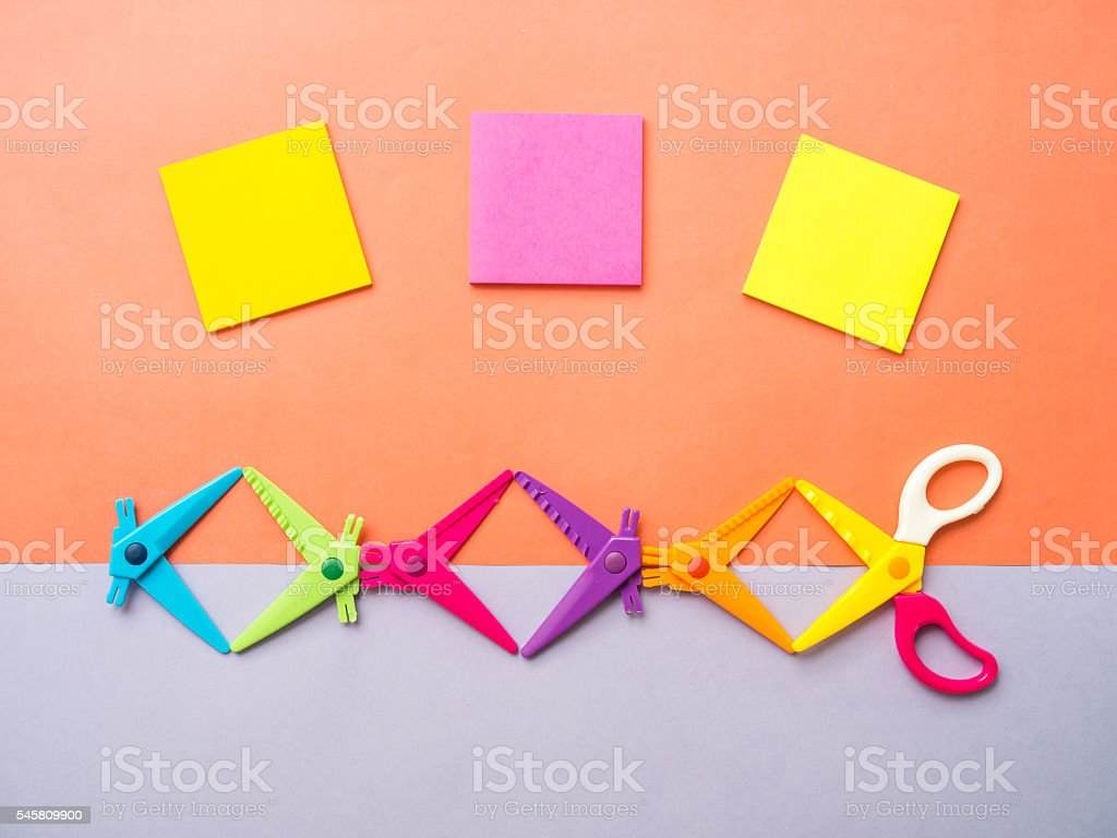 Top view colorful set of zigzag  scissors and sticky note stock photo