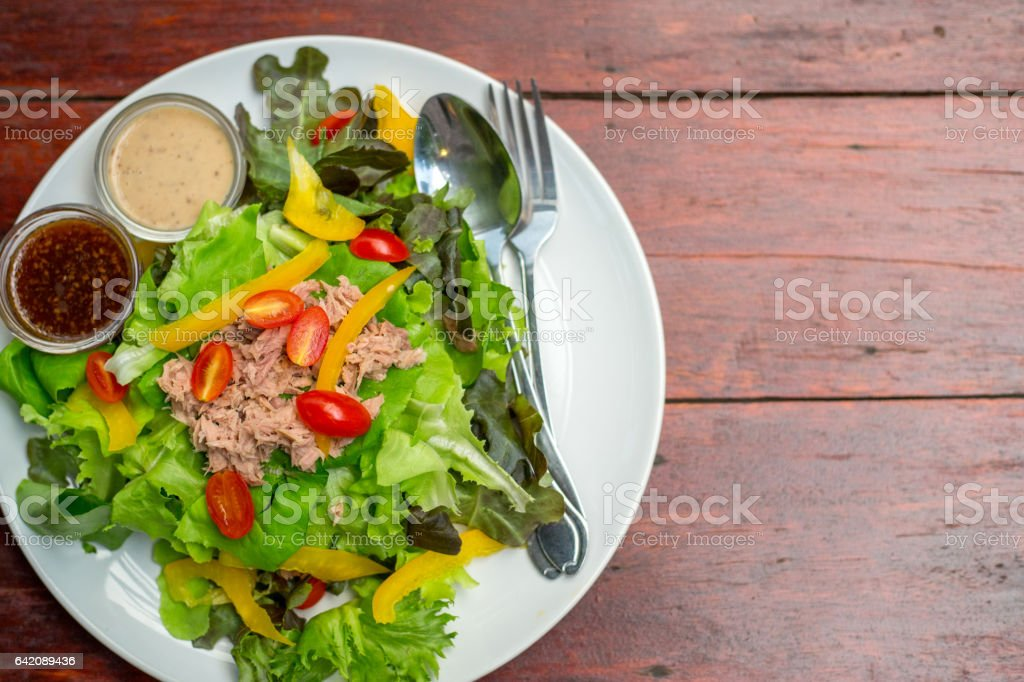 Top view Colorful Tuna Salad with dressing stock photo