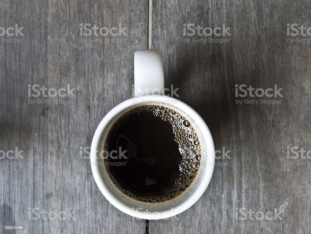 Top view cup of coffee on wood royalty-free stock photo