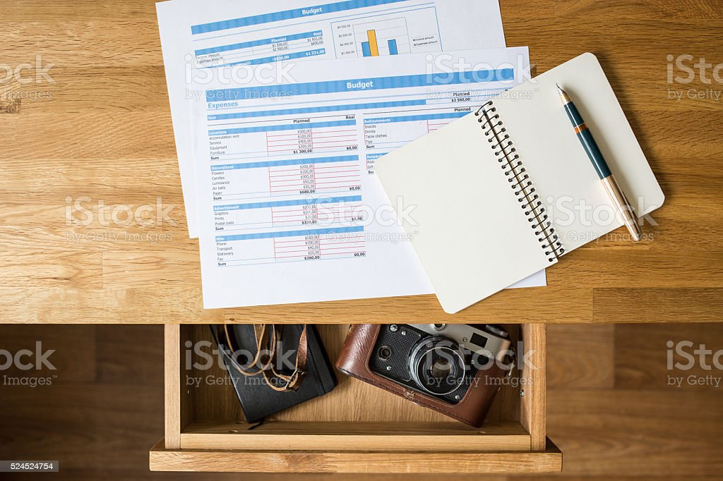 Top view desk with accounts on it and old camera stock photo