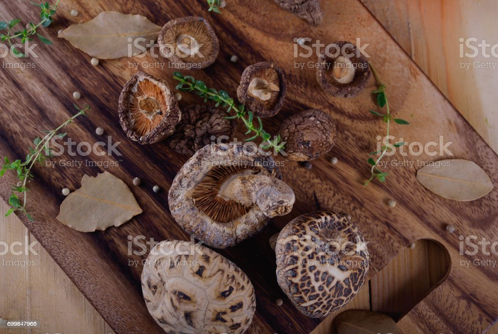 top view dried shiitake mushroom with herb on wooden board stock photo