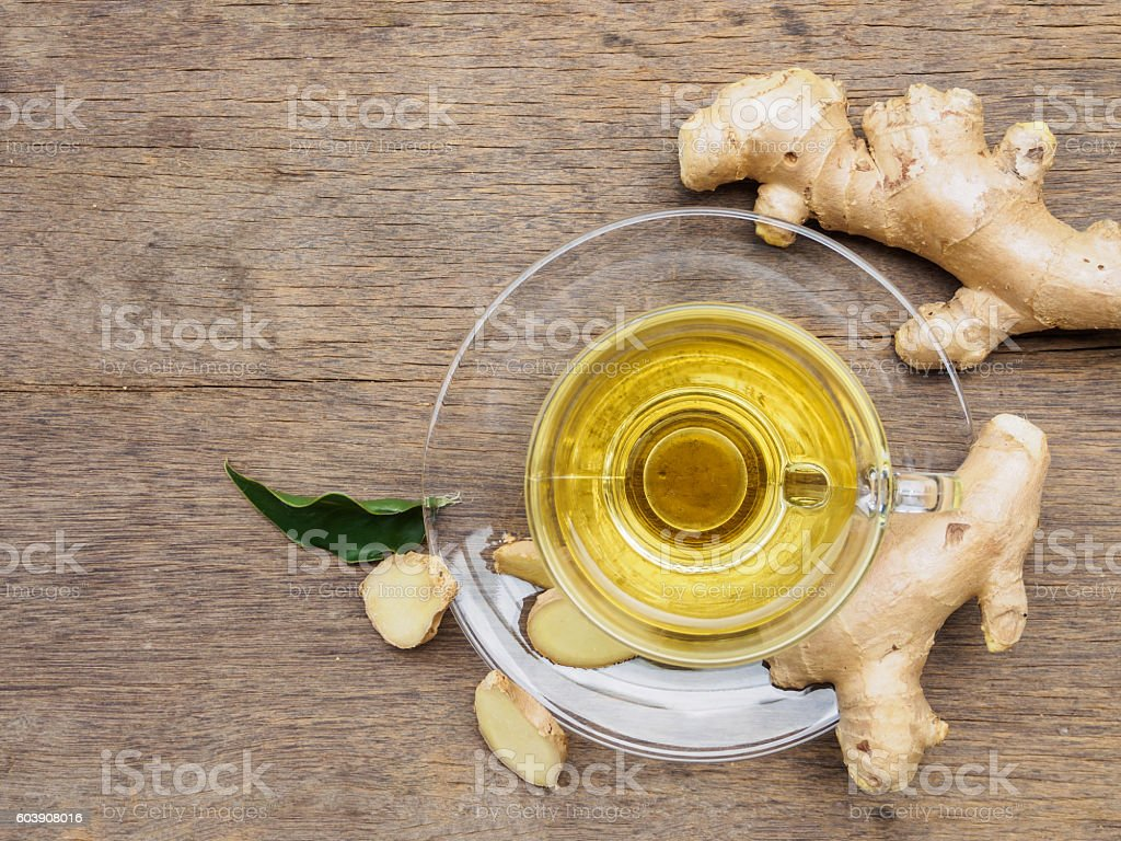 top view ginger tea cup with ginger root on wooden background with...
