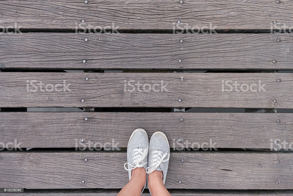 Top view gray sneakers on wooden bridge, Hipster style stock photo