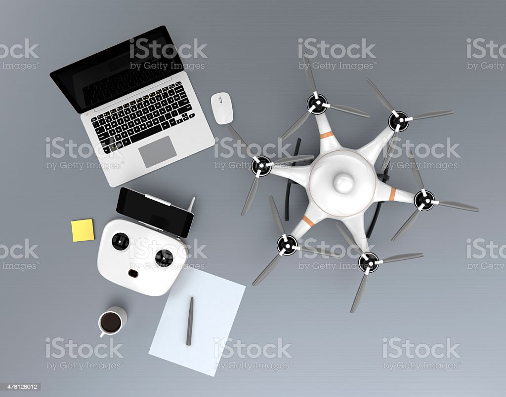 Top view hexacopter, remote controller, laptop computer. stock photo