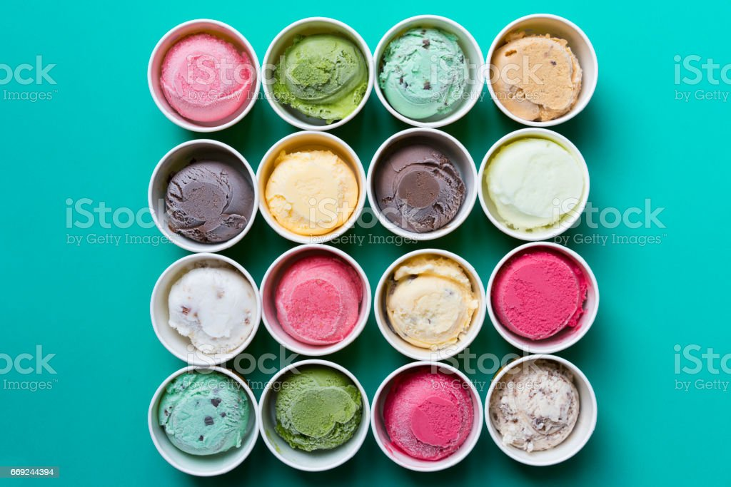 Top view Ice cream flavors in cup on green background stock photo