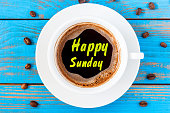 Top view image of morning coffee cup with phrase: happy