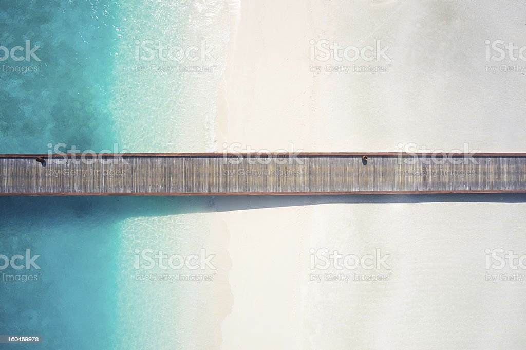 top view jetty over sandy beach and lagoon stock photo