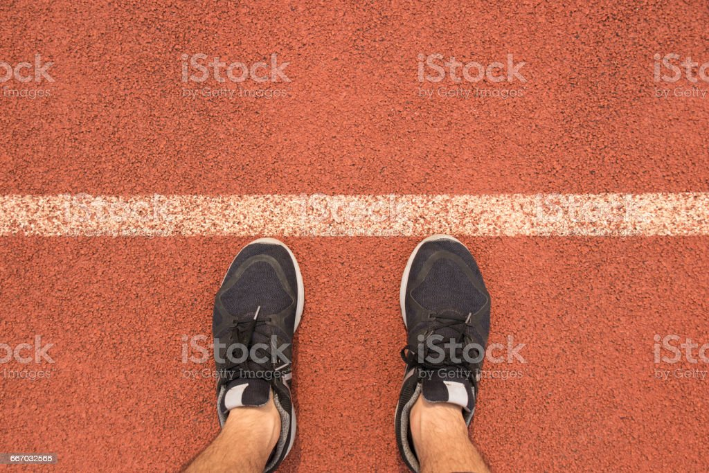Top view man wear running shoes on the starting line stock photo