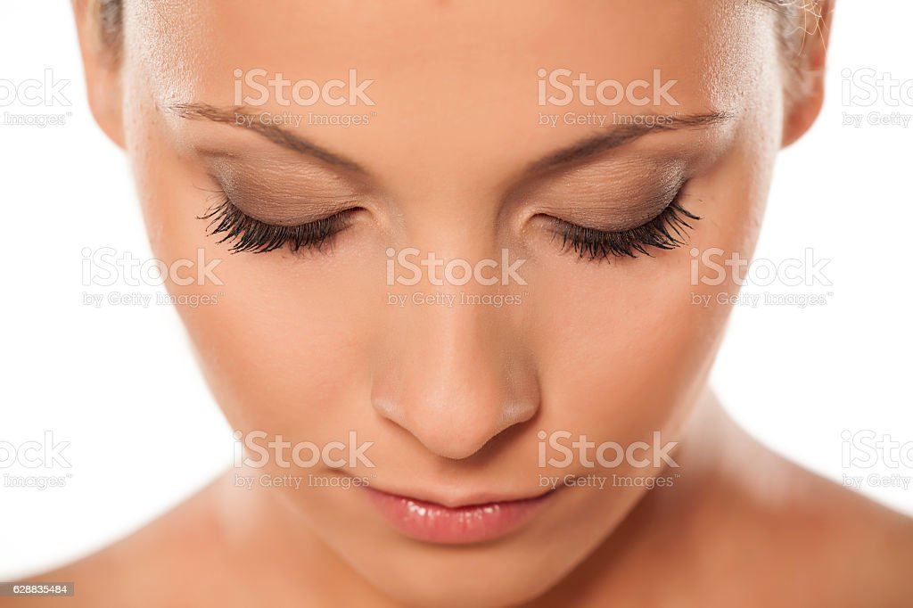 top view of a beautiful woman's face with natural lashes stock photo