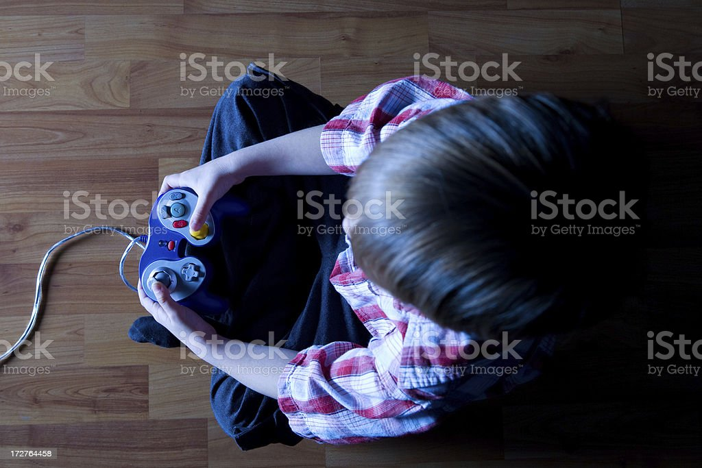 Top view of a boy playing video games royalty-free stock photo