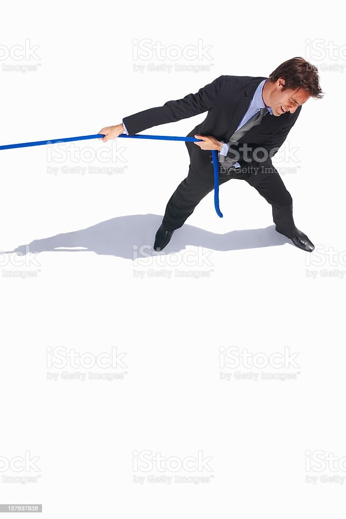 Top view of a business man pulling rope stock photo