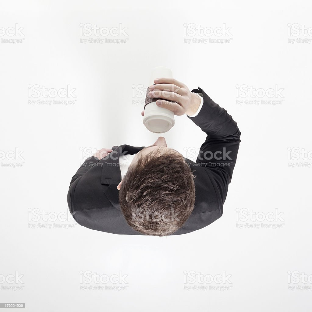 Top view of a businessman drinking coffee royalty-free stock photo