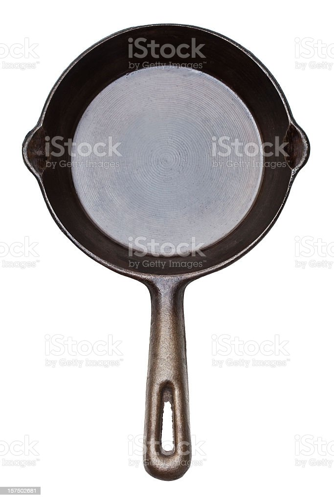 Top view of a cast iron frying pan on white background stock photo