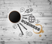 Top view of a cup of coffee and business icons