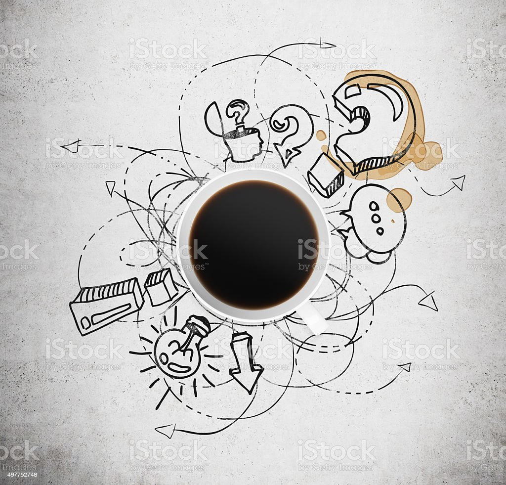 Top view of a cup of coffee and business icons stock photo