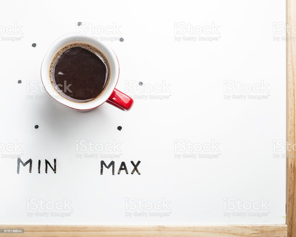 Top view of a cup of coffee in the form of volume control stock photo