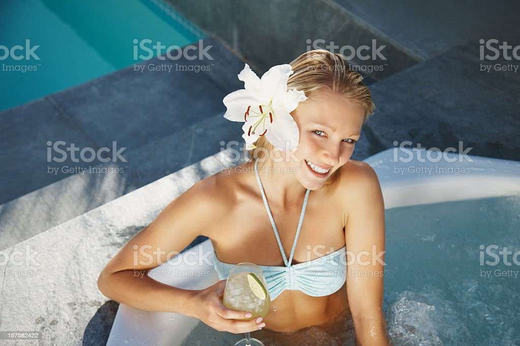 Top view of a happy woman enjoying drink in jacuzzi royalty-free stock photo