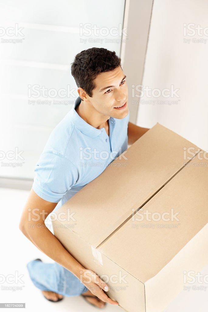 Top view of a man with box entering new house royalty-free stock photo