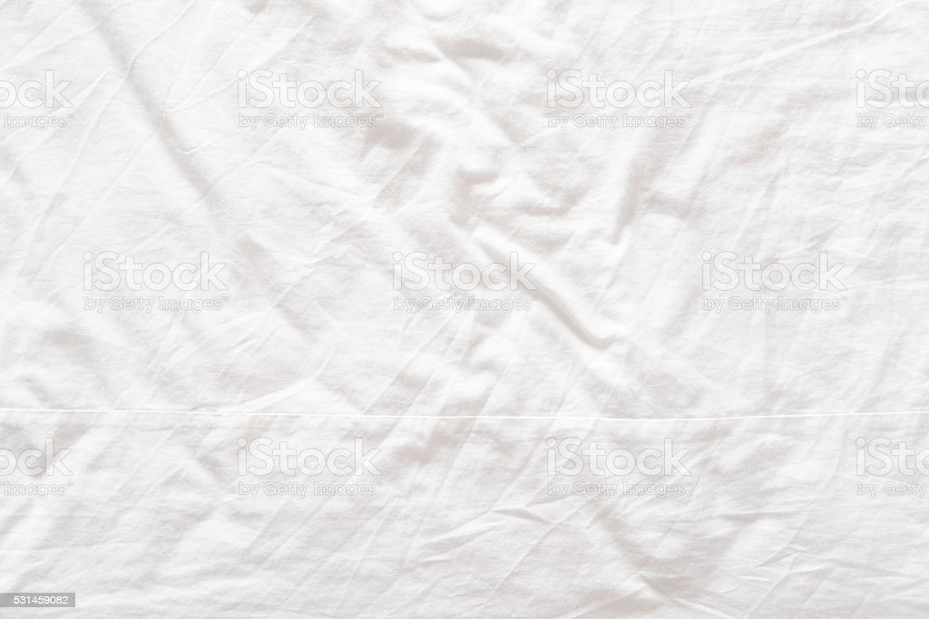 Top view of a messy bedding sheet after night sleep. stock photo