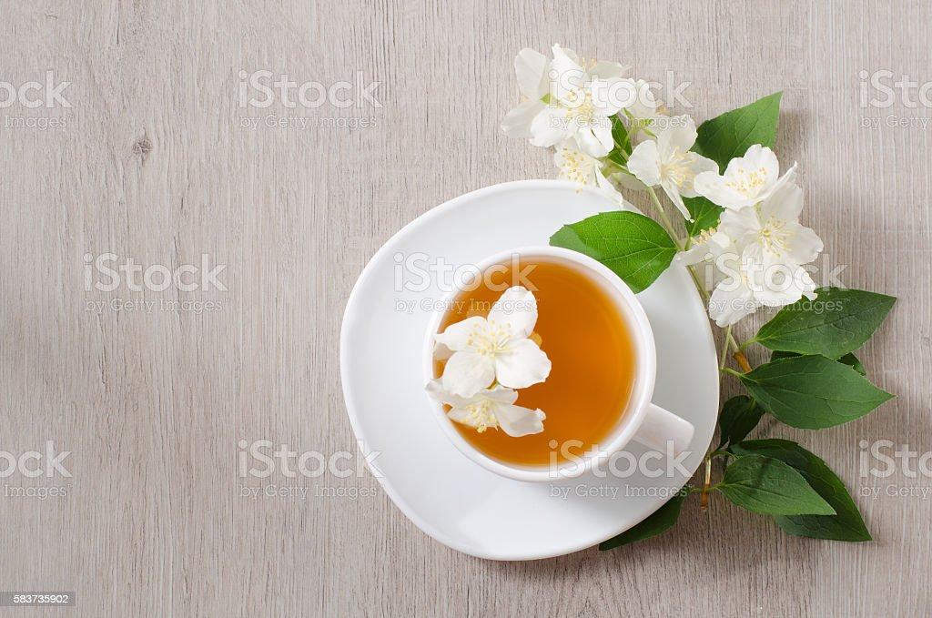 Top view of a mug of herbal tea and jasmine stock photo