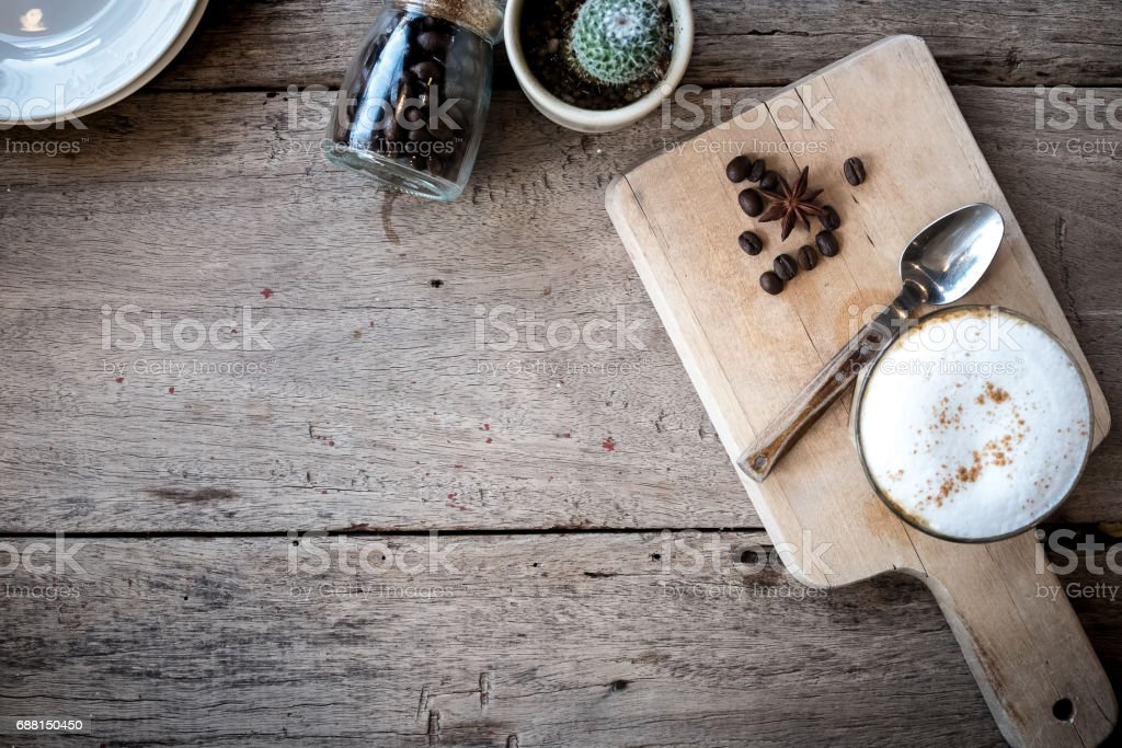 Top view of a red cup of hot coffee put on a wooden table.Vintage tone with copy space. stock photo