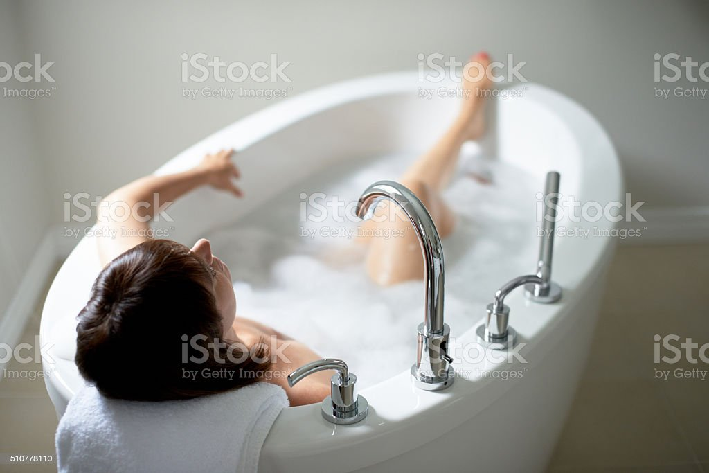 Top view of a serene mature woman in bathtub stock photo