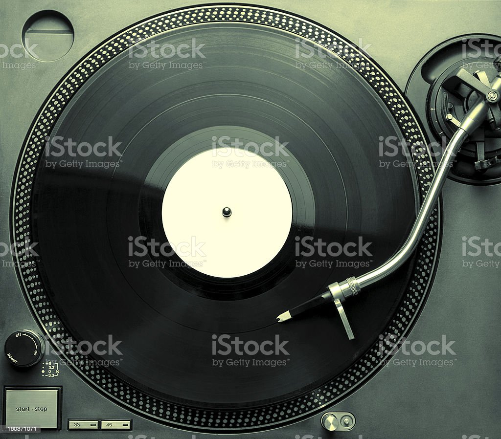 Top view of a spinning record on a gray turntable  stock photo