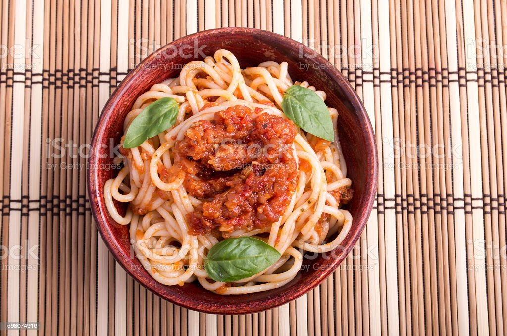 Top view of a thin spaghetti in a wooden bowl stock photo