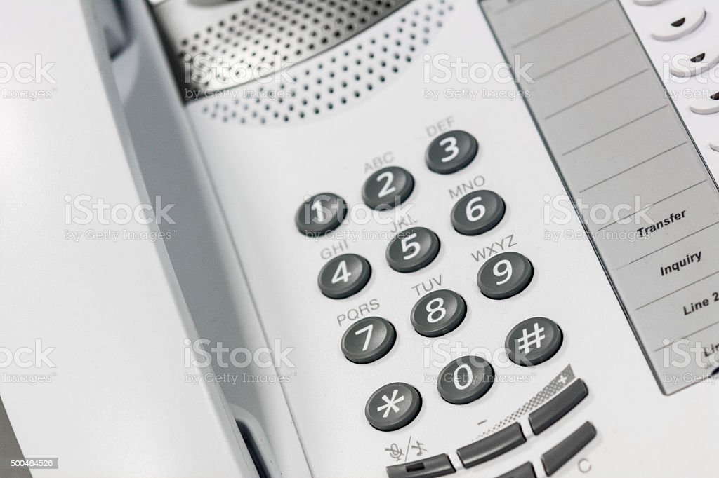 Top view of a white phone keypad handset stock photo