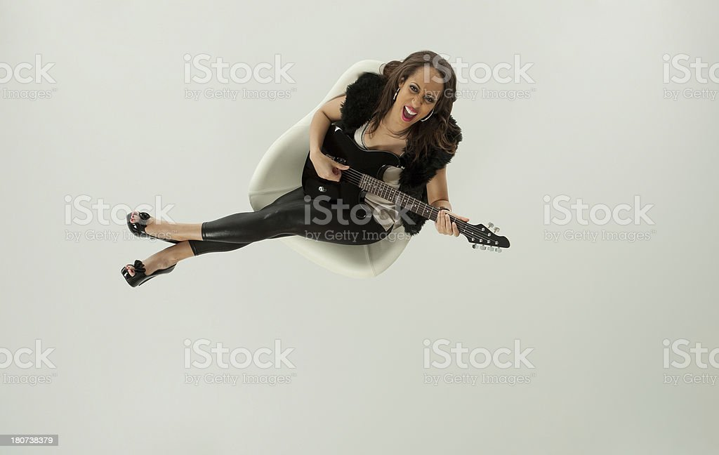 Top view of a woman playin guitar royalty-free stock photo