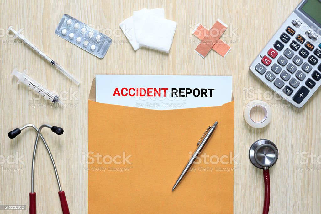 Top view of Accident report with letter envelope, medical device stock photo