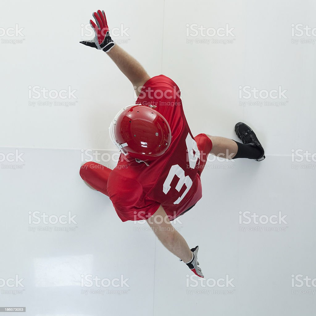 Top view of American football player in action royalty-free stock photo