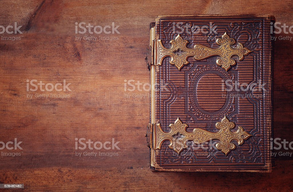 top view of antique book cover, with brass clasps stock photo