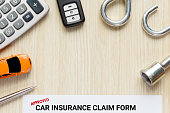Top view of approved car insurance claim form