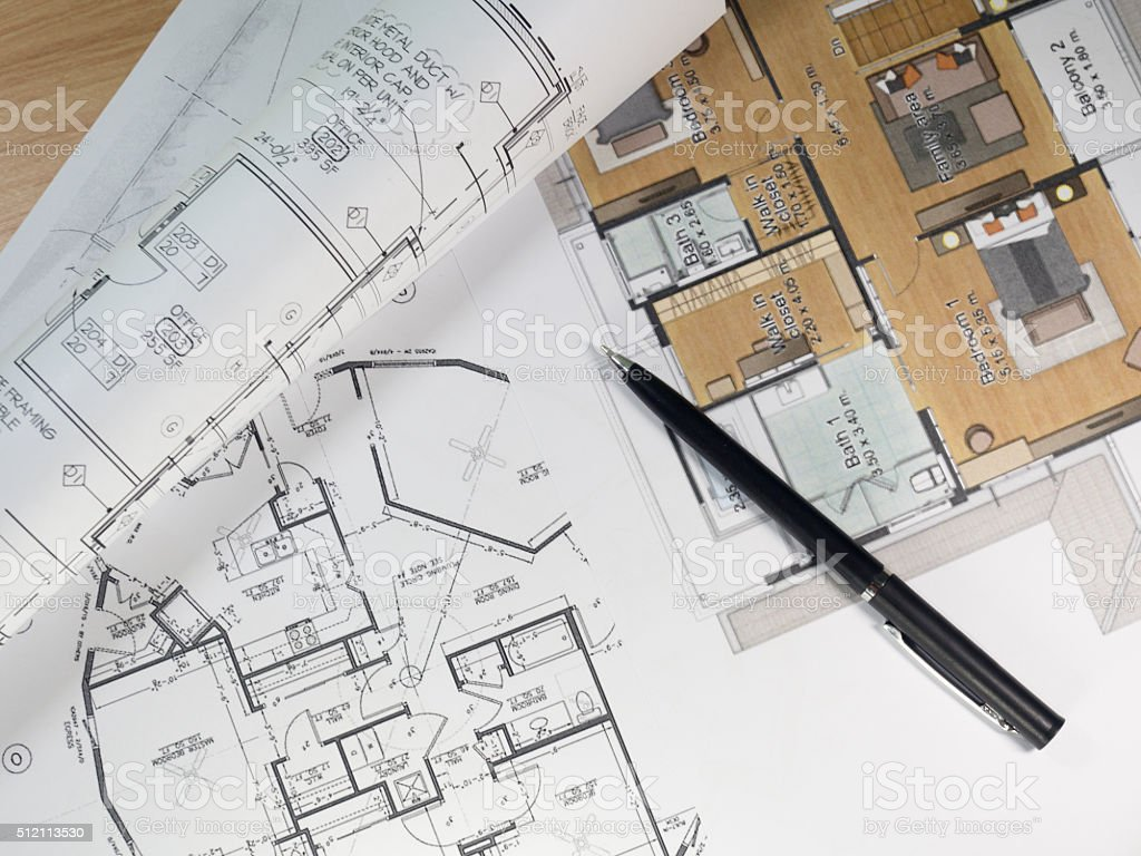 Top view of architectural blueprints and blueprint rolls stock photo
