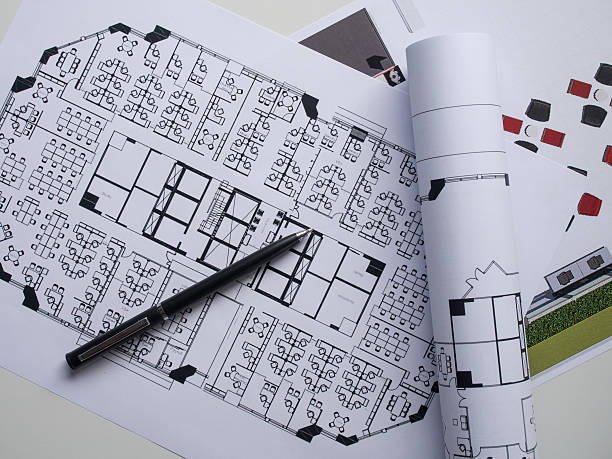 Holiday decorations and notebook with 2017 goals pictures images top view of architectural blueprints and blueprint rolls stock photo malvernweather Images