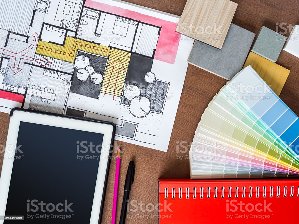 Top view of architecture hand-drawn sketch, tablet on creative workspace stock photo