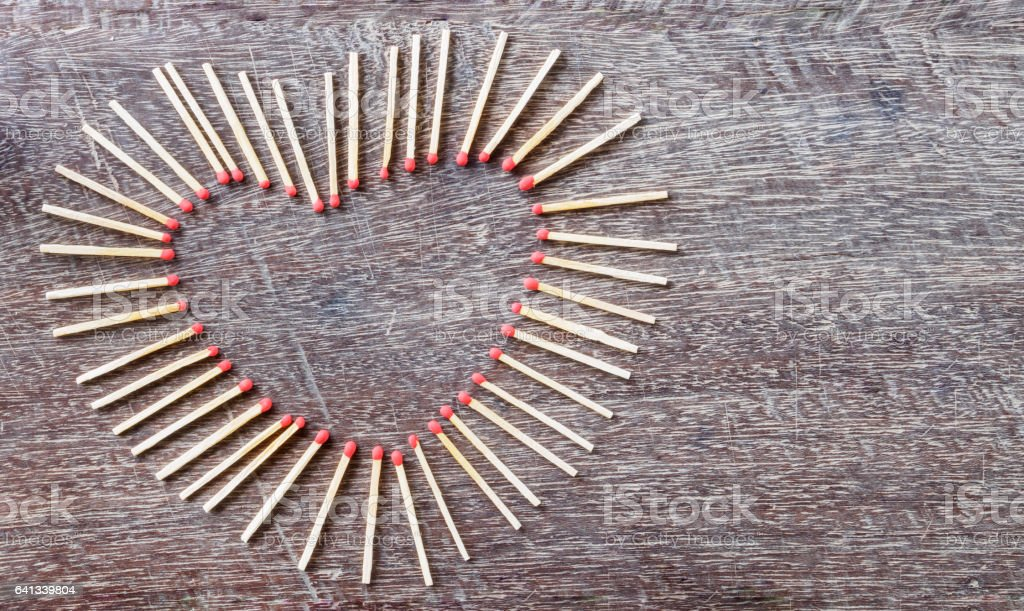 Top view of arranged matches are heart shape on old background stock photo
