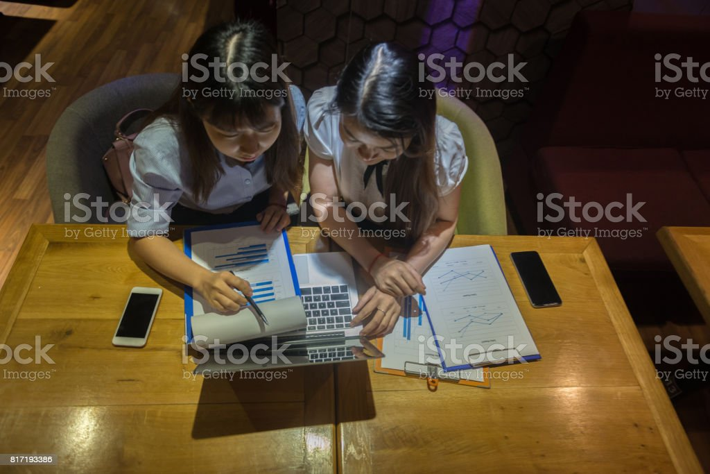 Top view of Asian businesswomen working overtime in their office stock photo