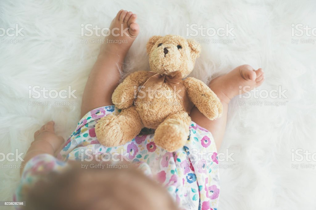Top view of baby with teddy bear stock photo