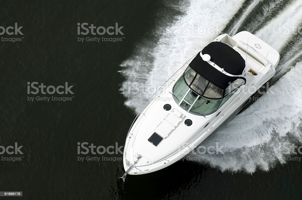 Top view of black and white speedboat on water royalty-free stock photo