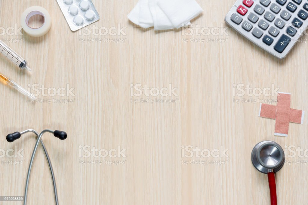 Top view of blank space with stethoscope, hypodermic syringe, plaster, gauze, calculator and  tape. stock photo