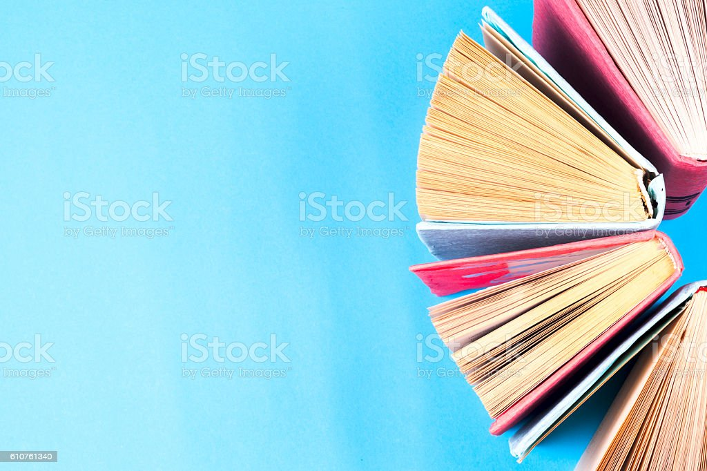 Top view of bright colorful hardback books in a circle. stock photo