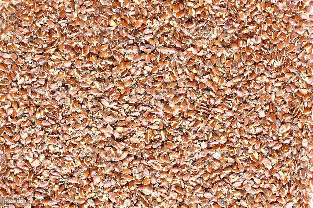 Top view of broken flax seeds stock photo