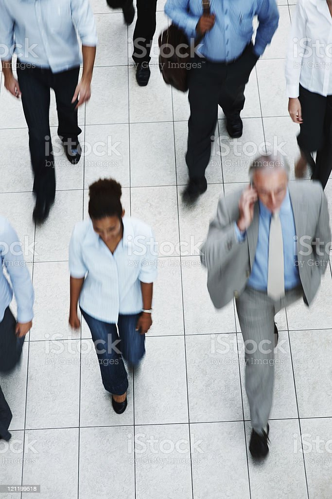 Top view of business executives walking on tiled floor royalty-free stock photo