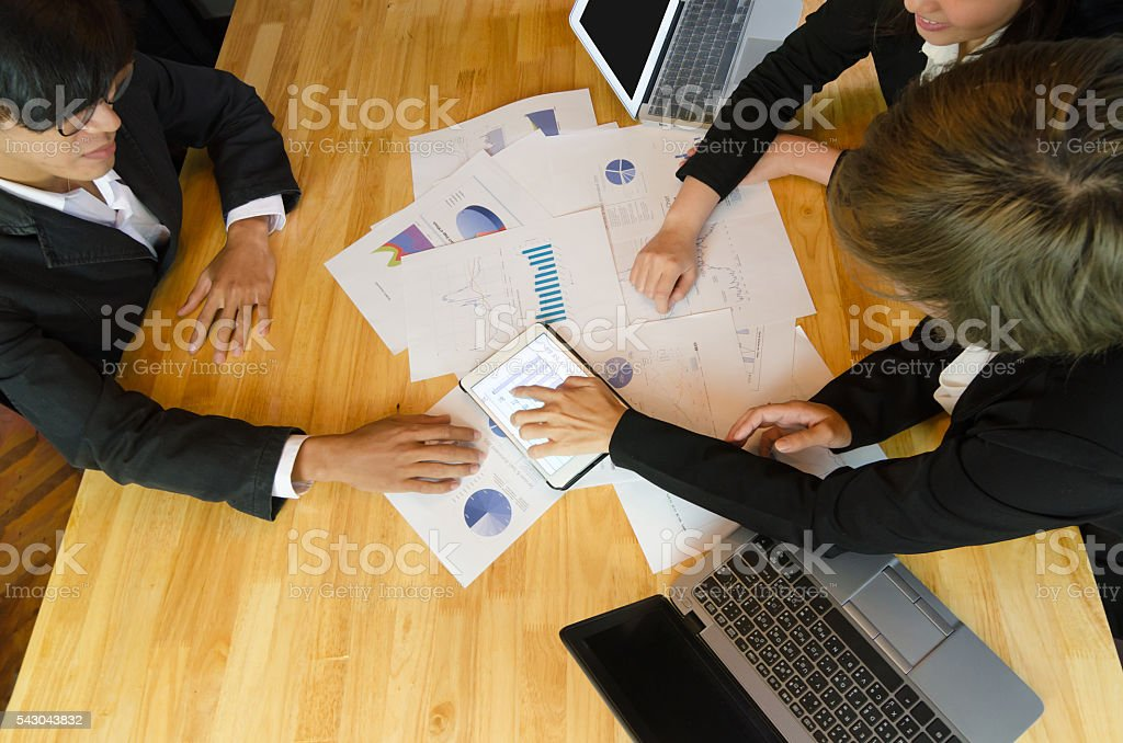 Top view of business people group view graph in tablet. stock photo