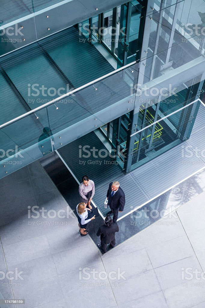 Top view of business people talking stock photo