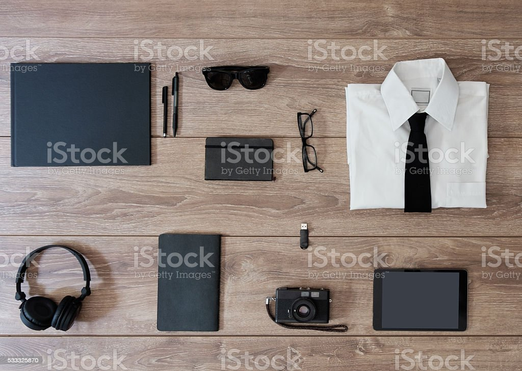top view of businessman clothes isolated on wooden background stock photo