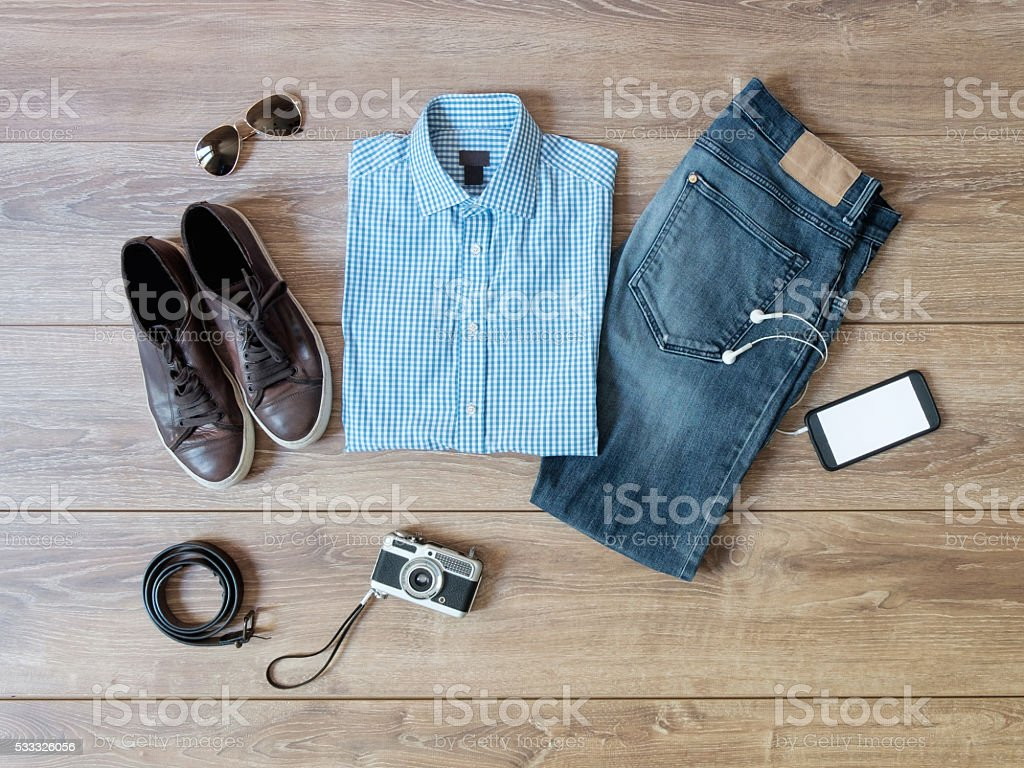 top view of casual clothes isolated on wooden background stock photo