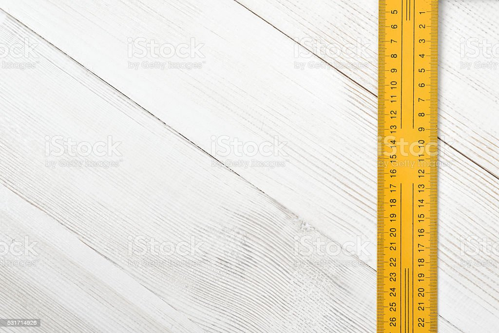 Top view of centimeter ruler on wooden surface with open stock photo